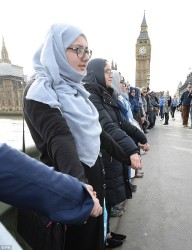Muslim women stand hand-in-hand in solidarity with the victims of London attack