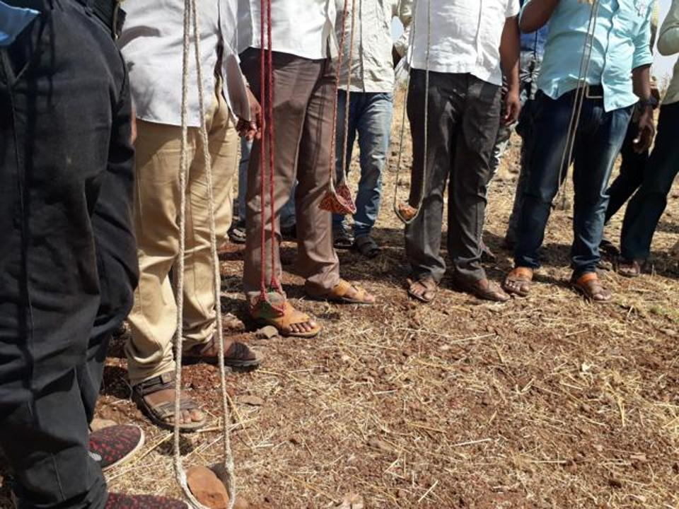 Tribal youths hold 'gofan' -- a traditional slingshot.